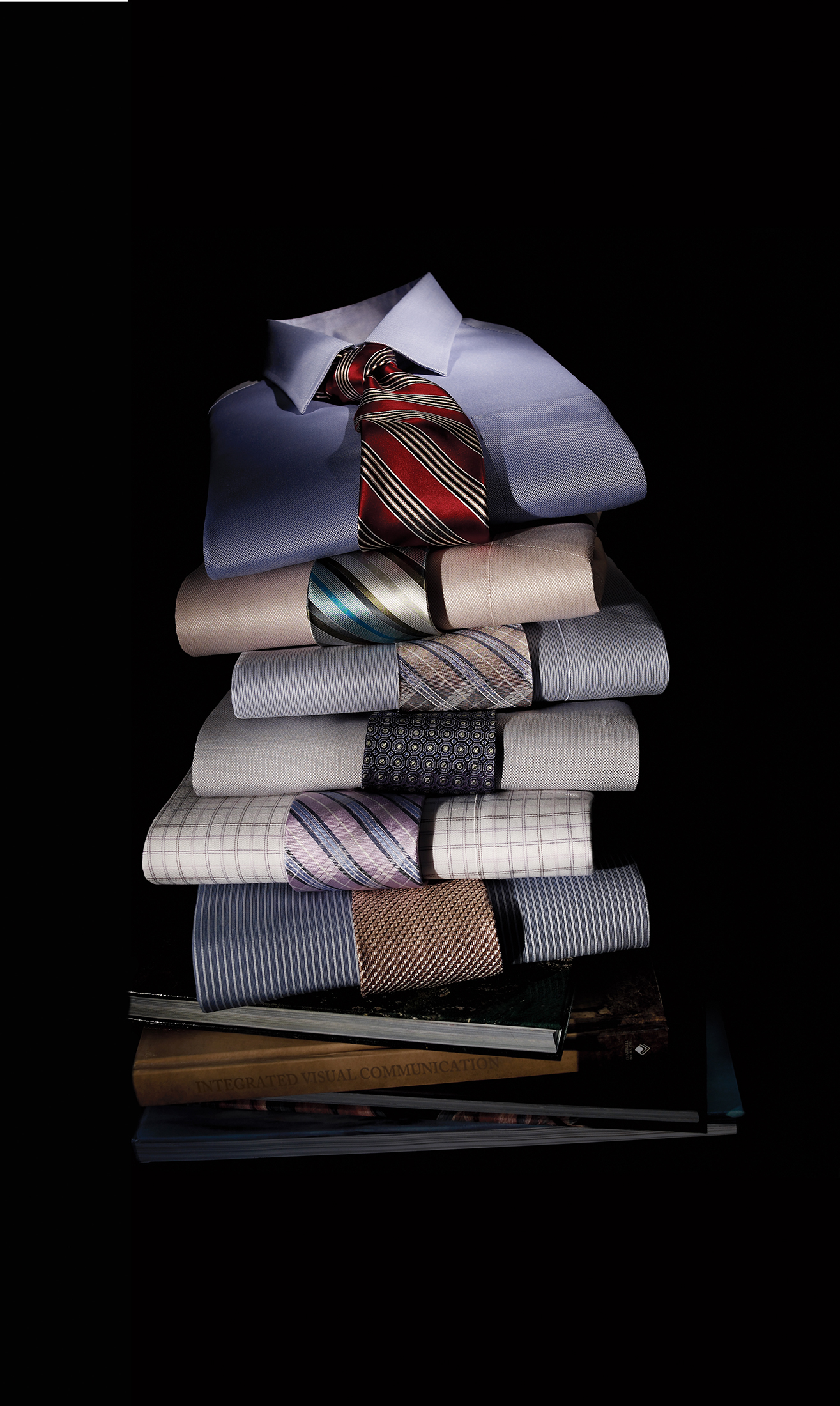 Photography - Pile of Folded Men's Dress Shirts and Ties