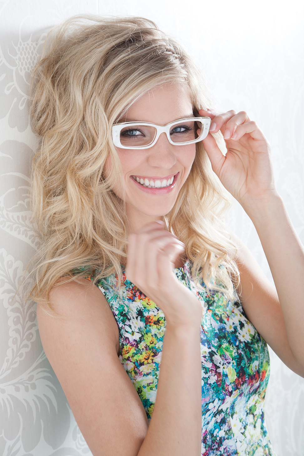 Photography - Fashion Blond Smiling Woman in Glasses