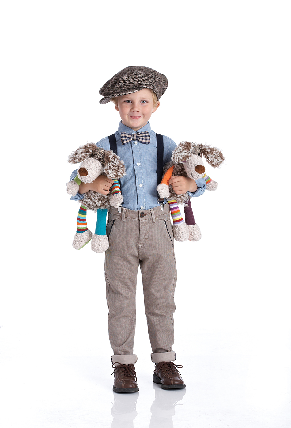 Photography - Boy Holding Stuffed Animals