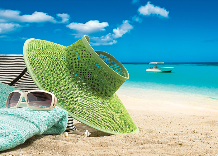 Photography - Hat on a Beach with Towel and Sunglasses